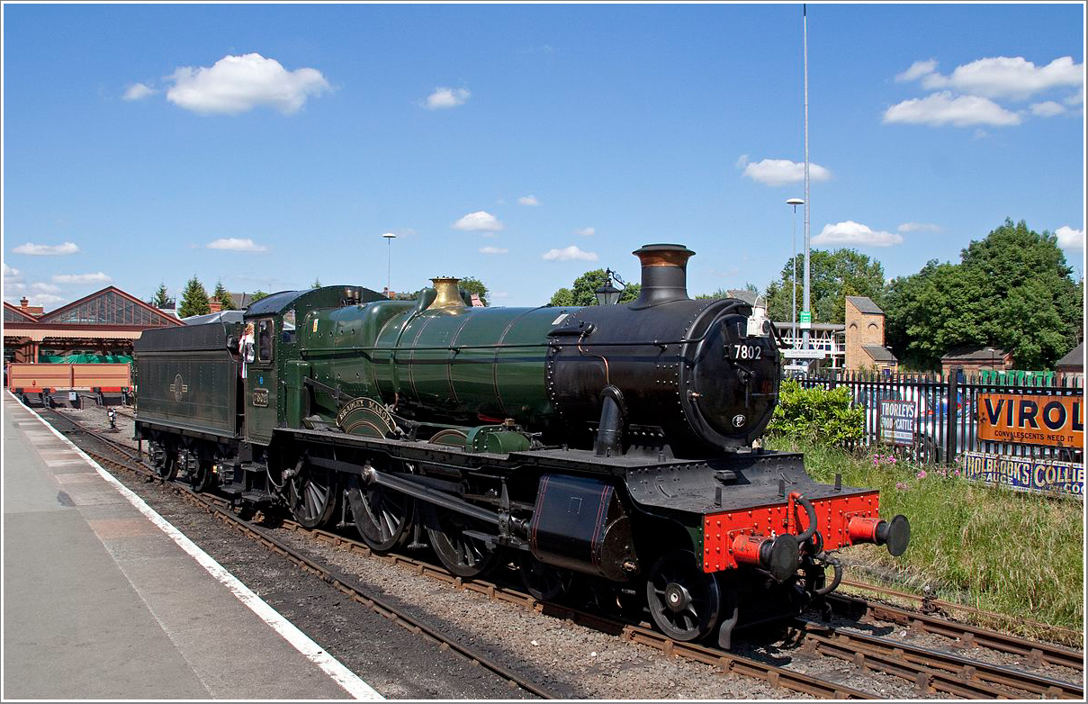 BR green 7802 Bradley Manor with small tender five carmine and cream  coaches at the SVR